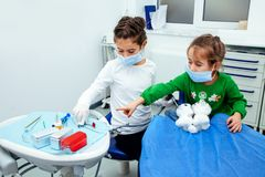 Treatment office children dentist teeth small girl teen red doctor new year discount woman clean clinic quietly comfortably Royalty Free Stock Image