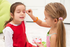 Little girls doing make up Royalty Free Stock Photo
