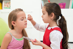 Little girls doing make up Royalty Free Stock Photography