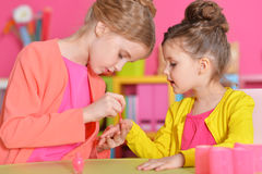 Little girls doing manicure. Cute little girls with stylish hairstyles doing manicure royalty free stock photography