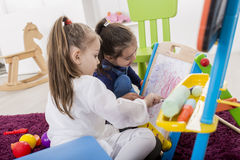 Little girls draw in the room Royalty Free Stock Photography
