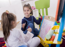 Little girls draw in the room Royalty Free Stock Image