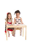 Little girls drawing on paper Royalty Free Stock Images