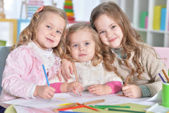 Little girls drawing. Three cute little girls drawing with pencils Stock Photography