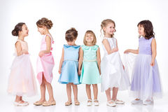 Little girls in dresses of princesses Royalty Free Stock Photo