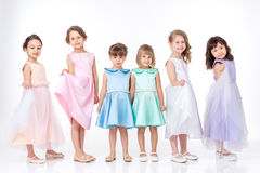 Little girls in dresses of princesses Stock Images