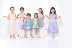 Little girls in dresses of princesses Stock Photo