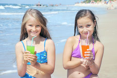 Little girls drinking juice Royalty Free Stock Image
