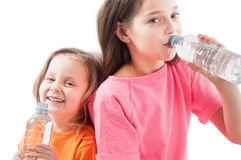 Little girls drinking mineral water Stock Photos