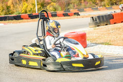 Little girls are driving Go- Kart car in a playground racing tra Stock Images