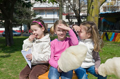 Little girls eating candy-floss Stock Photo