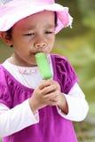 Little girls eating an ice cream. A little girls eating an ice cream royalty free stock photography