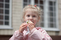 Little girls eating ice-cream. Outdoor shoot Royalty Free Stock Images