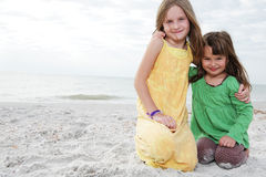 Little girls enjoy summer day at the beach. Stock Photography