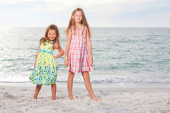 Little girls enjoy summer day at the beach. Stock Photo