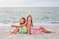 Little girls enjoy summer day at the beach. Royalty Free Stock Images