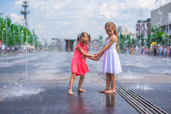 Little girls enjoy sunny day in open street Royalty Free Stock Images