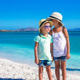 Little girls enjoy their summer vacation on the Royalty Free Stock Images
