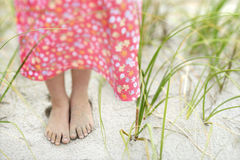 Little Girls Feet in the Sand. Closeup of a little girl's barefoot feet that are covered in sand. Horizontal shot Stock Images