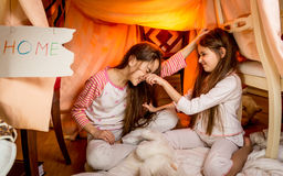 Little girls fighting on floor at bedroom Royalty Free Stock Images
