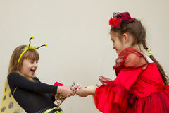Little girls fighting over a toy royalty free stock image