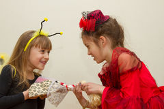 Little girls fighting and shared doll. The conflict between two sisters. the kids are fighting, fight over for toy Royalty Free Stock Photo