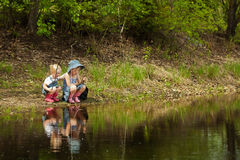 Little girls are fishing Royalty Free Stock Photography