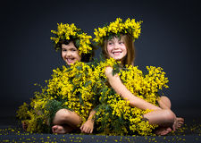 Little girls with floral dress Stock Photos