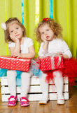 Little girls in fluffy skirts with gift boxes Stock Photo