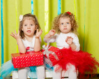 Little girls in fluffy skirts with gift boxes Stock Images