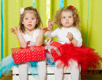 Little girls in fluffy skirts with gift boxes Royalty Free Stock Photography