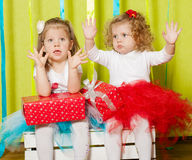 Little girls in fluffy skirts with gift boxes Royalty Free Stock Images