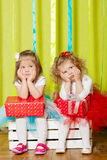 Little girls in fluffy skirts with gift boxes Stock Photos