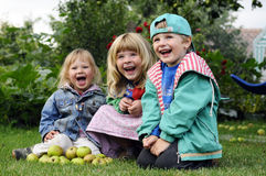 Little girls in garden Stock Images