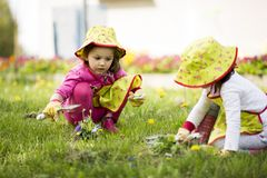 Little girls in the garden Royalty Free Stock Images