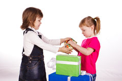 Little girls with gift boxes Stock Image