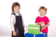 Little girls with gift boxes Stock Images
