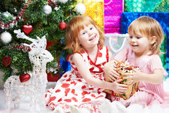 Little girls with gifts at Christmas or new year Royalty Free Stock Image