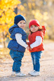 Little girls - girlfriends walk in the park. Stock Photography