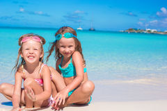 Little girls in glasses for swimming playing with Royalty Free Stock Images