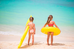 Little girls going to swim on summer beach vacation Royalty Free Stock Photos