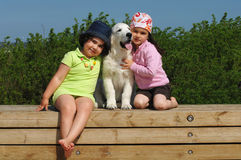 Little girls with a Golden retriever Royalty Free Stock Photography