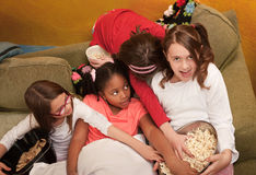 Little Girls Grab Popcorn Stock Photo