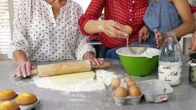 Little girls, grandma and his mom preparing cake stock video footage