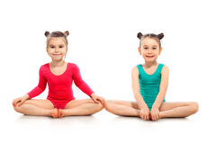 Little girls gymnast on a white background Royalty Free Stock Images