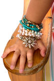 Little Girls Hand With Beads And Bracelets Royalty Free Stock Photo