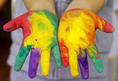 Little girls hands painted. Colorful hands of little girl`s Royalty Free Stock Photo