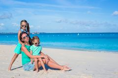 Little girls and happy mother during tropical Stock Images