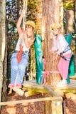 Little girls having fun in adventure park. Little girls are climbing in adventure park royalty free stock photography