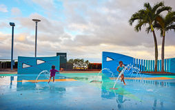 Little girls having fun in Cairns Esplanade public water park in Royalty Free Stock Image